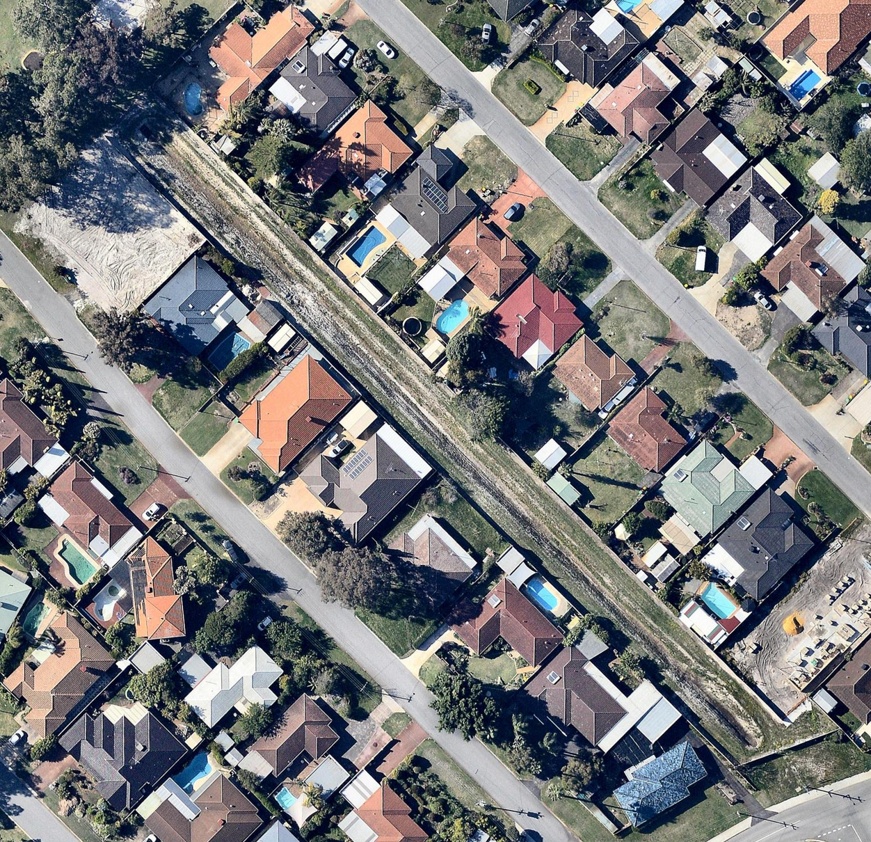 An aerial view of houses backing onto a 90-metre long open drain in Perth