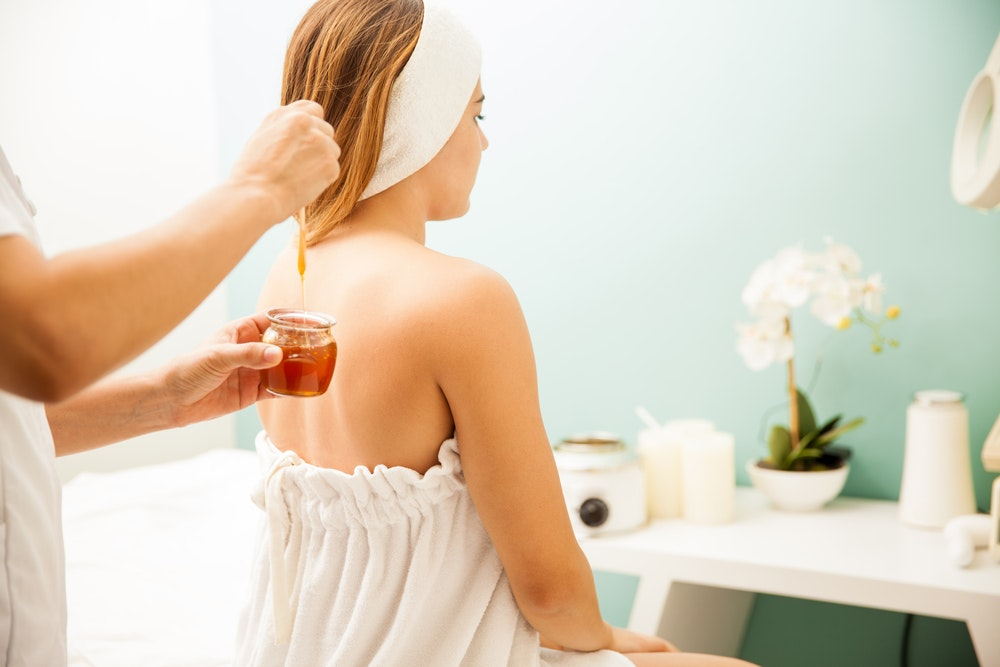 Image of honey being applied to hair