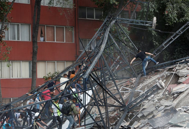 Mexico City residents are forming spontaneous work brigades to save neighbors' lives. Reuters/Ginnette Riquelme